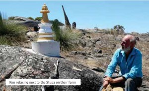 Kim relaxing next to the Stupa on their farm
